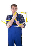Worker with yardstick Royalty Free Stock Photo