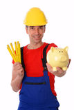 Worker with yardstick and piggy bank Royalty Free Stock Photography