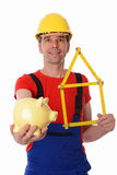 Worker with yardstick and piggy bank Stock Photography