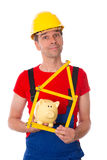 Worker with yardstick and piggy bank Royalty Free Stock Photos