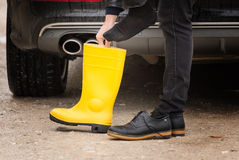 Worker with yellow boots. Closeup Stock Photos