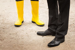 Worker with yellow boots. Closeup Stock Photo
