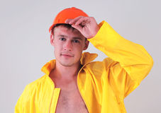 Worker in yellow uniform Royalty Free Stock Images