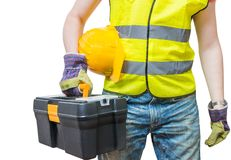 Worker in yellow vest holds tool box.  on white. Background Royalty Free Stock Photo