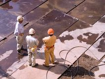 Workers. Three workers at the construction site Royalty Free Stock Photo