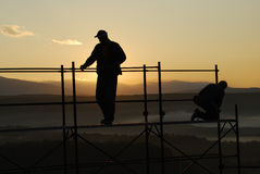 Workers. Silhouette of workers at sunrise Royalty Free Stock Photography