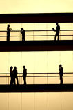 Workers. Silhouette in sepia tone at a modern building Stock Photo