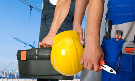 Workers. Different workers man closeup on building background Stock Images