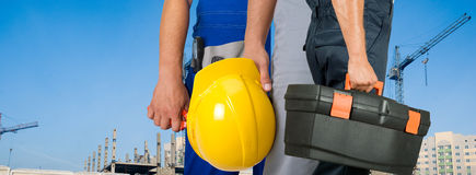 Workers. Different workers man closeup on building background Stock Image