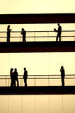 Workers. Silhouette in a modern building Royalty Free Stock Image