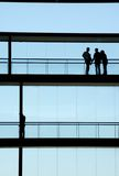 Workers. People inside the modern building in silhouette Royalty Free Stock Photo