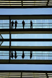 Workers. Inside the modern building in silhouette Stock Photo