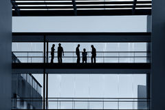 Workers. Inside the modern building in silhouette Stock Images