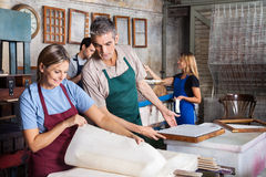 Workers Analyzing Papers In Factory Stock Photography