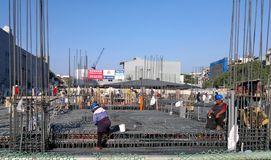 Workers at Apartment Construction Site royalty free stock photography
