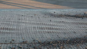 Workers applying reinforcement mesh on a surface in preparation for paving stock video