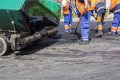 Workers on Asphalting road Stock Photography