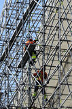 Workers assemble metal construction Royalty Free Stock Photo