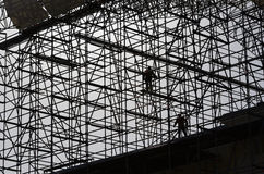 Workers assemble metal construction Stock Image