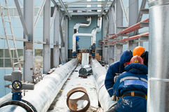 Workers assemble pipelines stock photography