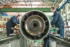 Workers assembly aviation engine Royalty Free Stock Images