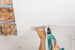 Workers are assembly gypsum wall. Plasterboard stock images