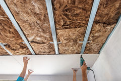 Workers are assembly gypsum wall. Plasterboard is under construction royalty free stock photo