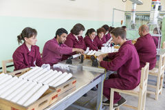 Workers at an assembly line in munition factory Royalty Free Stock Photography
