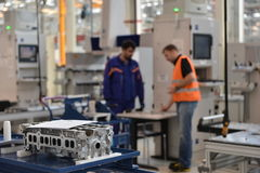 Workers in auto engines factory Stock Image