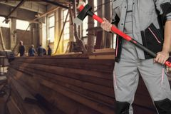 At the sawmill. Workers with ax at the sawmill background Stock Photos