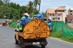 Workers on the back of a rubbish truck Stock Photography