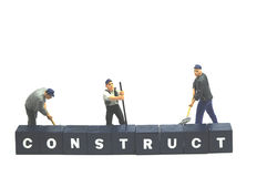 Workers behind word construct Stock Images