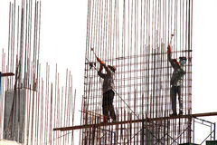 Workers  binding steel bars. At  the construction site Stock Photography
