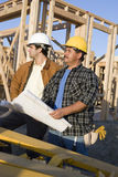 Workers With Blueprint At Site Royalty Free Stock Photography