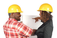 Workers with blueprints Royalty Free Stock Image