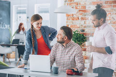 Workers brainstorming in office Stock Image