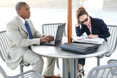 Workers on Break. A man and woman business team taking a break stock image