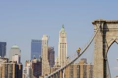 Workers on Brooklyn Bridge in Manhattan royalty free stock photo