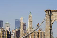 Workers on Brooklyn Bridge in Manhattan Stock Photography