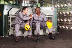 Workers brotherhood. Textile industry blue collar workers brotherhood royalty free stock photo