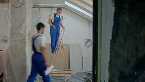 Workers build a House. 108. Professional shot with high dynamic range. You can use it e.g. in your construction, commercial video, business, presentation stock video