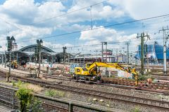 Workers build new rail tracks in Cologne / Germany in Juni 2019. Workers build new rail tracks in Cologne / Germany at the main train station near Dom in Juni stock image