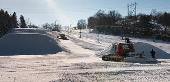 Workers build terrain park at  ski field. Afton Alps, Minnesota Royalty Free Stock Photography