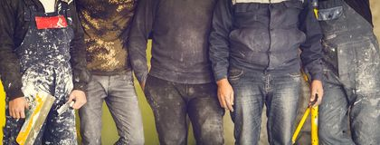 Workers and builders and foreman are as gang with dirty uniform are staying in apartment that is under construction, remodeling,. Renovation,extension stock photos
