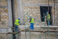 Working builders stock image