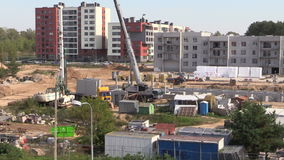 Workers building flat apartment house with crane stock footage