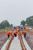 Workers  building a railway. Stock Images