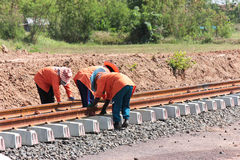 Workers  building a railway. Royalty Free Stock Images