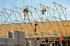 Workers building the stage for a concert in Italy Stock Photos