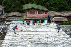 Workers are building a steel roof frame on high. Stock Images